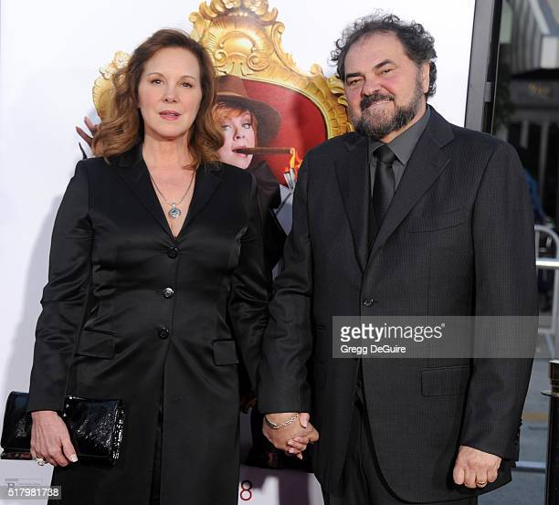 Actress Elizabeth Perkins and cinematographer Julio Macat arrive at the premiere of USA Pictures' 'The Boss' at Regency Village Theatre on March 28...