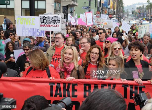 Actress Elizabeth Perkins journalist Lauren Sivan and California State Senator Connie Leyva participate in the Take Back The Workplace March and...