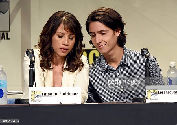 Actress Elizabeth Rodriguez and actor Lorenzo James Henrie speak onstage at AMC's Fear the Walking Dead panel during ComicCon International 2015 at...