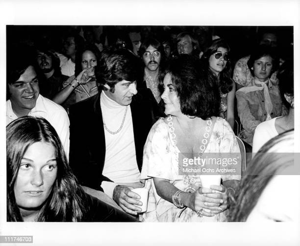Actress Elizabeth Taylor and Henry Wynberg attending an event c 1974