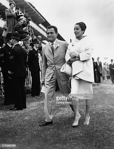 Actress Elizabeth Taylor and her husband, director Mike Todd, attending the races on Derby Day at Epsom Racecourse, England, June 5th 1957.
