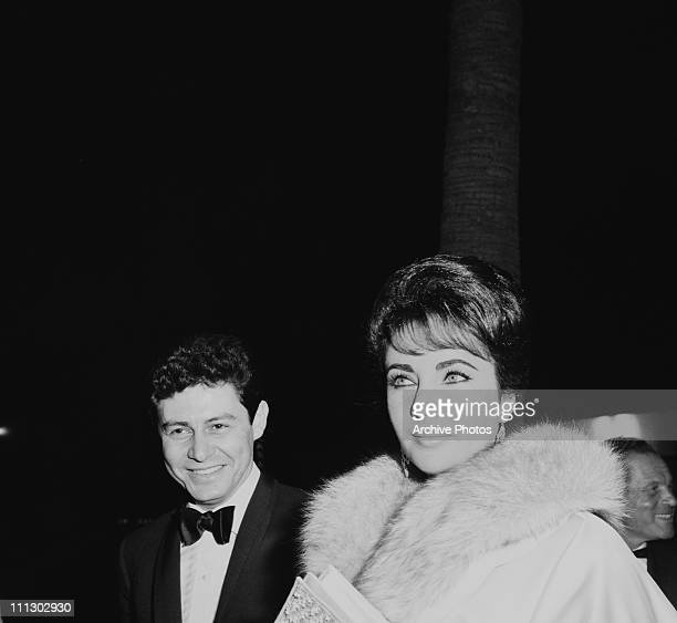 Actress Elizabeth Taylor and her husband, singer Eddie Fisher attend the Hollywood premiere of the film 'Suddenly Last Summer', Los Angeles, 22nd...