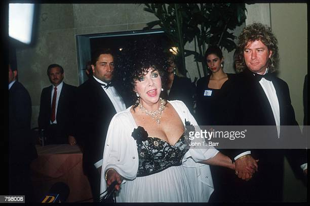 Actress Elizabeth Taylor and Larry Fortensky attend Ronald Reagan's eightieth birthday celebration at the Beverly Hilton February 6 1991 in Los...