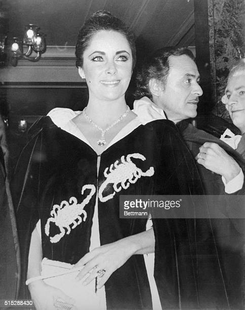 Actress Elizabeth Taylor arrives resplendent for Princess Grace's 40th birthday party November 15th wearing the $1000 diamond her husband actor...