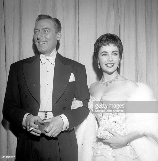 Actress Elizabeth Taylor attends an Academy Awards party at Romanoff's Restaurant with her second husband actor Michael Wilding on March 25 1954 in...