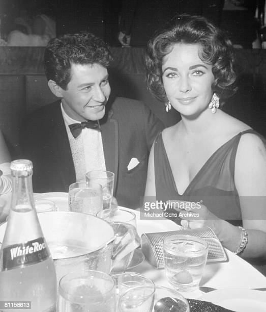 Actress Elizabeth Taylor attends an event with her husband entertainer Eddie Fisher in circa 1959 in Los Angeles, California.