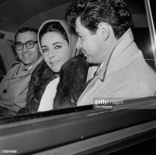 Actress Elizabeth Taylor leaves hospital with her husband singer and actor Eddie Fisher 17th November 1960