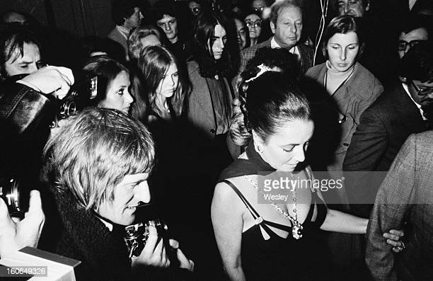 Actress Elizabeth Taylor on her husband Richard Burton's arm at his 50th birthday party at the Dorchester Hotel London 10th November 1975