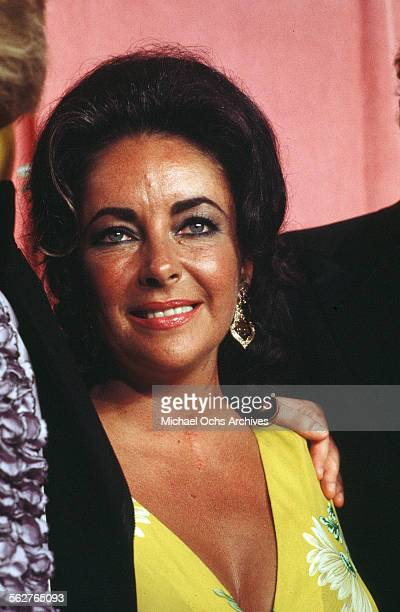 Actress Elizabeth Taylor poses backstage during the Academy Awards show at Dorothy Chandler Pavilion in Los AngelesCalifornia