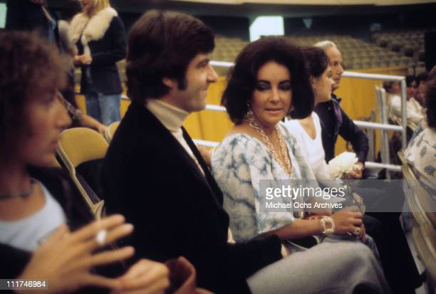 Actress Elizabeth Taylor seated with Henry Wynberg c 1974