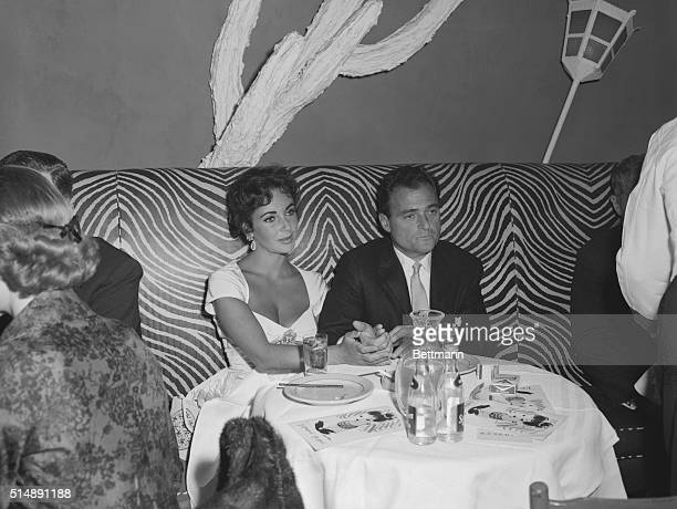 Actress Elizabeth Taylor sitting with producer Mike Todd at the popular El Morocco nightclub 154 East 54th Street New York City