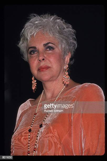 Actress Elizabeth Taylor stands at a fashion event benefitting AIDS September 26 1997 in Los Angeles CA Taylor has raised millions of dollars for...