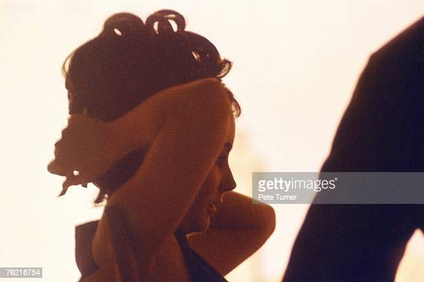 Actress Elizabeth Taylor takes a break in the dressing room of the Cleopatra set at the Cinecitta Studio just outside Rome Italy in February 1962...