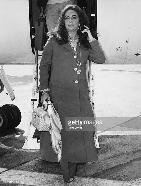 Actress Elizabeth Taylor walking down the steps of her husband's private jet as she arrives at Heathrow Airport London September 10th 1970