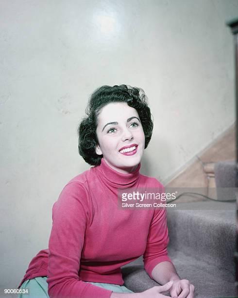 Actress Elizabeth Taylor wearing a pink poloneck top circa 1955