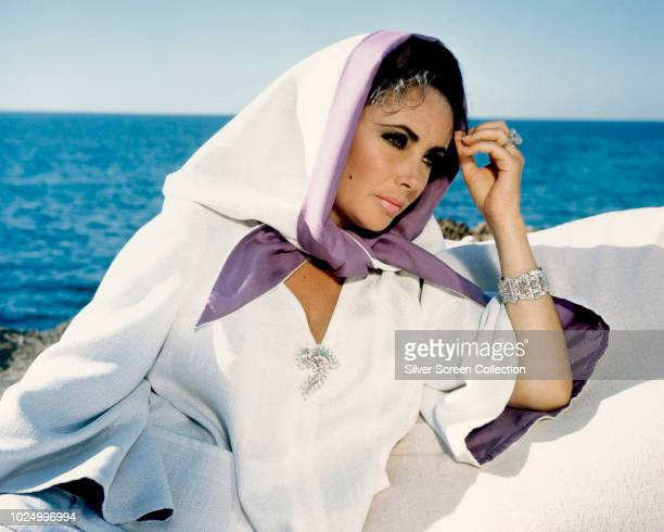 Actress Elizabeth Taylor wearing a white robe during the filming of 'The Sandpiper', 1965.
