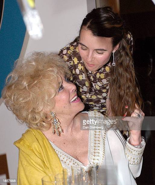 Actress Elizabeth Taylor with her granddaughter Naomi Wilding at a private dinner held in Taylor's honor on March 18 2003 at the Frederick R Weisman...