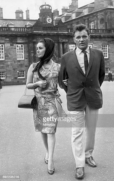 Actress Elizabeth Taylor with her husband Richard Burton stroll in the grounds of Holyrood Palace during a visit to Edinburgh 22nd July 1963