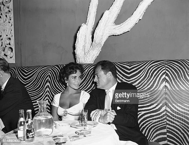 Actress Elizabeth Taylor with producer Mike Todd at the El Morocco nightclub dated February 14th 1957