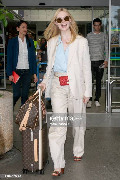Actress Elle Fanning arrives ahead of the 72nd annual Cannes Film Festival at Nice Airport on May 12, 2019 in Nice, France.