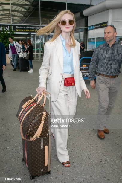 Actress Elle Fanning arrives ahead of the 72nd annual Cannes Film Festival at Nice Airport on May 12 2019 in Nice France