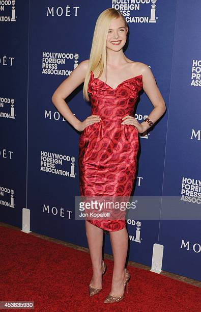 Actress Elle Fanning arrives at The Hollywood Foreign Press Association Installation Dinner at The Beverly Hilton Hotel on August 14 2014 in Beverly...