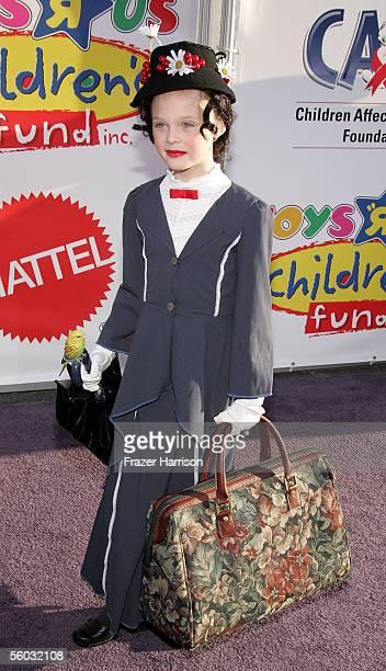Actress Elle Fanning attends the 12th Annual Dream Halloween Fundraiser held at Santa Monica Airport October 29 2005 in Santa Monica California