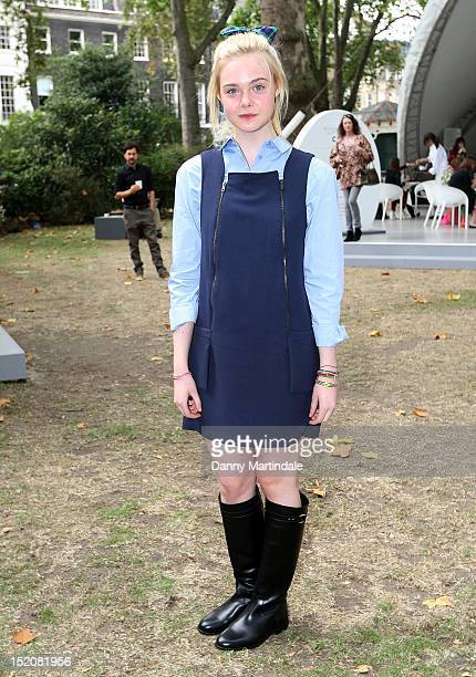 Actress Elle Fanning attends the front row for the Unique show on day 3 of London Fashion Week Spring/Summer 2013 at The Topshop Venue on September...