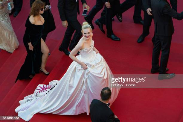 Actress Elle Fanning attends the Ismael's Ghosts screening and Opening Gala during the 70th annual Cannes Film Festival at Palais des Festivals on...