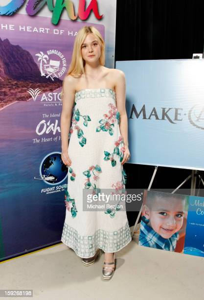 Actress Elle Fanning attends the poster signing event for charity during the Critics' Choice Movie Awards 2013 at Barkar Hangar on January 10 2013 in...
