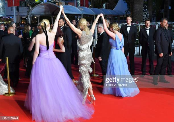 US actress Elle Fanning AustralianUS actress Nicole Kidman and US actress Kirsten Dunst hold hands as they leave on May 24 2017 following the...