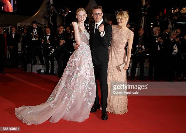 """Actress Elle Fanning, director Nicolas Winding Refn and Liv Corfixen attend a screening of """"The Neon Demon"""" at the annual 69th Cannes Film Festival..."""