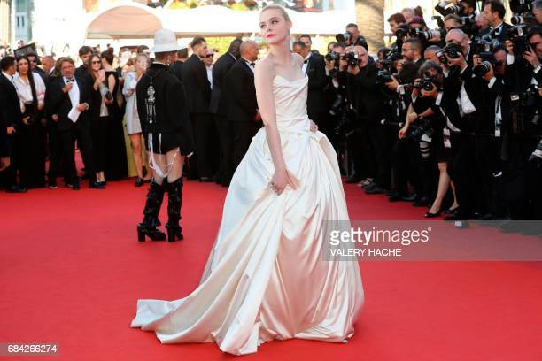 US actress Elle Fanning poses as she arrives on May 17 2017 for the screening of the film 'Ismael's Ghosts' during the opening ceremony of the 70th...