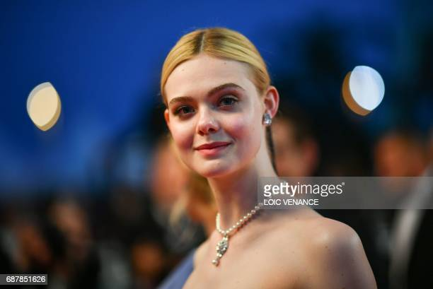 US actress Elle Fanning poses as she leaves on May 24 2017 following the screening of the film 'The Beguiled' at the 70th edition of the Cannes Film...