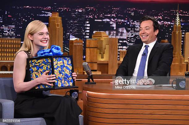 Actress Elle Fanning receives a large box of bubble gum from host Jimmy Fallon as she visits 'The Tonight Show Starring Jimmy Fallon' at Rockefeller...