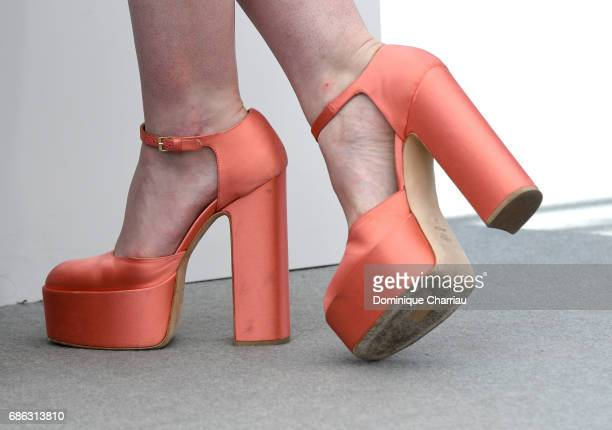 Actress Elle Fanning shoe detail attends the 'How To Talk To Girls At Parties' photocall during the 70th annual Cannes Film Festival at Palais des...