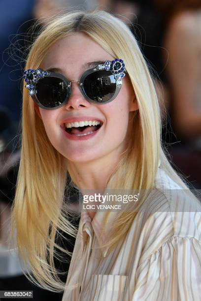 US actress Elle Fanning smiles as she arrives on May 16 2017 at the Grand Hyatt Cannes Hotel Martinez on the eve of the opening ceremony of the 70th...