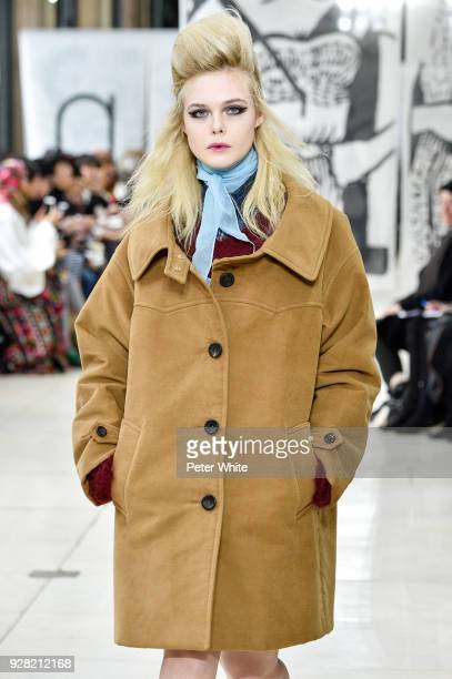 Actress Elle Fanning walks the runway during the Miu Miu show as part of the Paris Fashion Week Womenswear Fall/Winter 2018/2019 on March 6 2018 in...