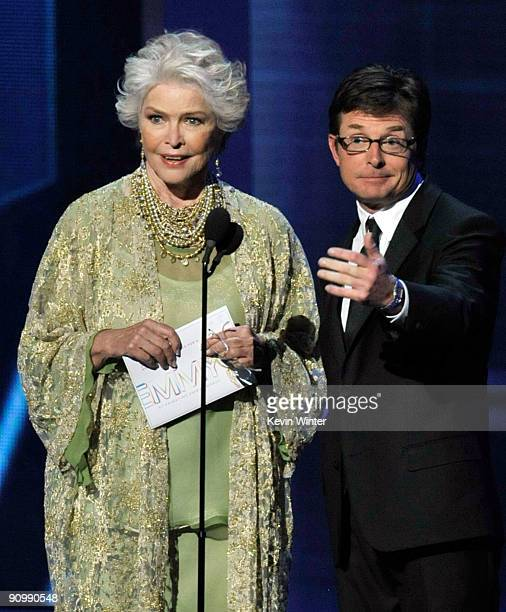 Actress Ellen Burstyn and actor Michael J Fox present the Outstanding Directing/Writing for a Drama Series awards onstage during the 61st Primetime...