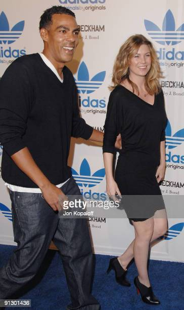 Actress Ellen Pompeo and husband Chris Ivery pose at the David Beckham And James Bond Adidas Originals on September 30, 2009 in Los Angeles,...