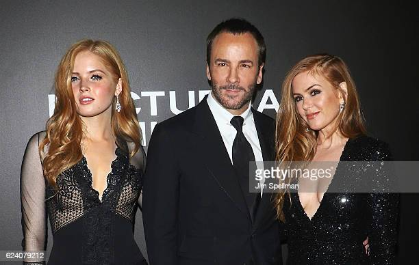 Actress Ellie Bamber director Tom Ford and actress Isla Fisher attend the Nocturnal Animals New York premiere at The Paris Theatre on November 17...