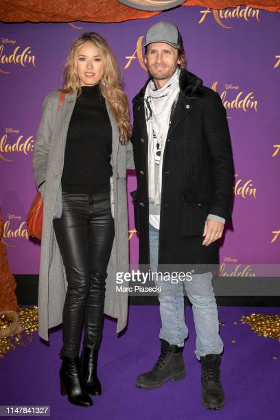 """Actress Elodie Fontan and director Philippe Lacheau attend the """"Aladdin"""" Paris Gala Screening at Cinema Le Grand Rex on May 08, 2019 in Paris, France."""