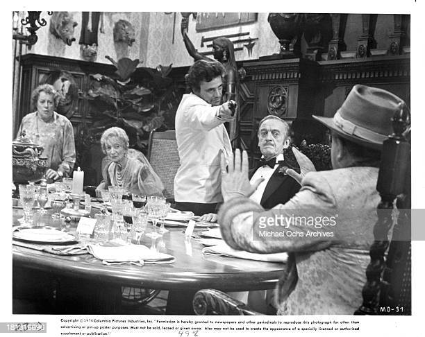 Actress Elsa Lanchester Estelle Winwood actor Peter Falk and actor David Niven on the set of Columbia Pictures movie Murder by Death in 1976