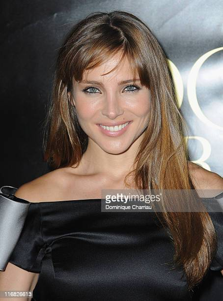 Actress Elsa Pataky poses as she arrives for Giorgio Armani 'Idol' Perfume launch at Cafe de l'Homme on July 7 2009 in Paris France