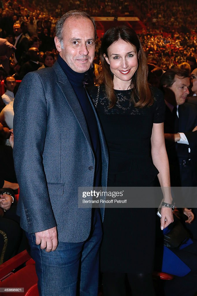 Actress Elsa Zylberstein and CEO of group Conde Nast France, Xavier Romatet attending Celine Dion's Concert at Palais Omnisports de Bercy on December 5, 2013 in Paris, France.