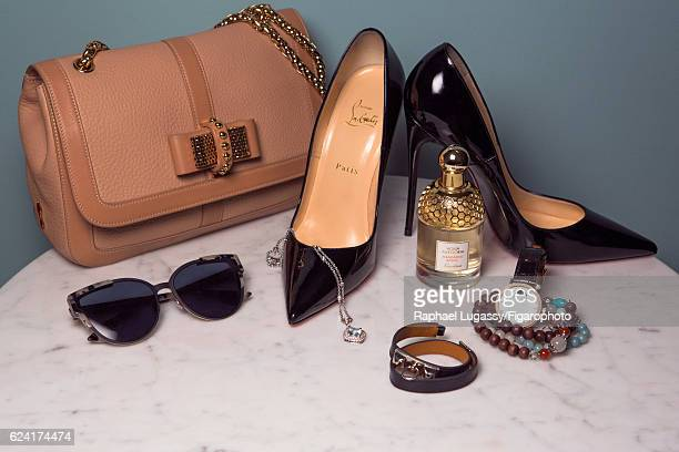 Actress Elsa Zylberstein's style inspirations are photographed for Madame Figaro on October 13 2016 in Paris France Bag and shoes sunglasses bracelet...