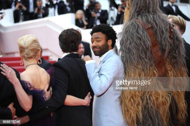 Actress Emilia Clarke actors Alden Ehrenreich Donald Glover and Chewbacca attend the screening of 'Solo A Star Wars Story' during the 71st annual...