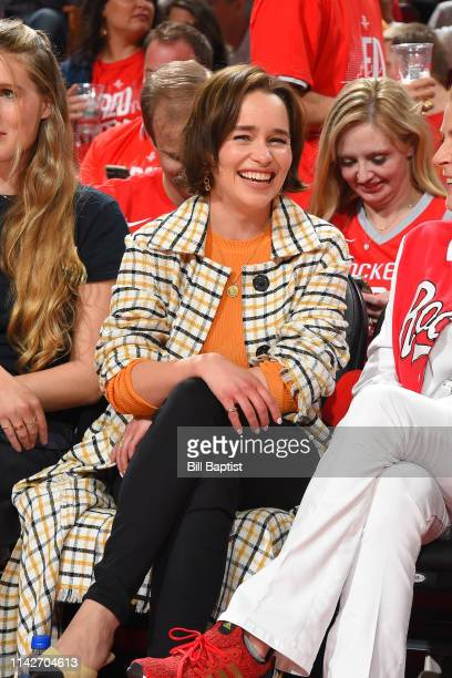 Actress Emilia Clarke attends a game between the Golden State Warriors and the Houston Rockets during Game Six of the Western Conference Semifinals...