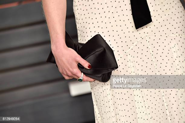 Actress Emilia Clarke purse and jewelry detail attends the 2016 Vanity Fair Oscar Party Hosted By Graydon Carter at the Wallis Annenberg Center for...