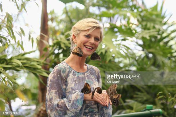 Actress Emilia Fox is surrounded by exotic butterflies in the 'RHS Butterfly Dome with Eden' at the Hampton Court Palace Flower Show on July 8 2013...